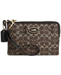Coach Embossed Signature Canvas Corner Zip Wristlet - Brown